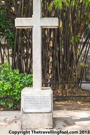 Cross marking the resting place of 600 Filipino and American prisoners