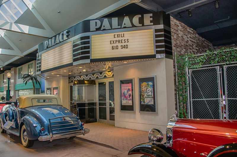 old cars in front of theater