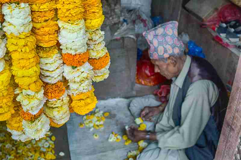 Napal Man making Flower wreaths