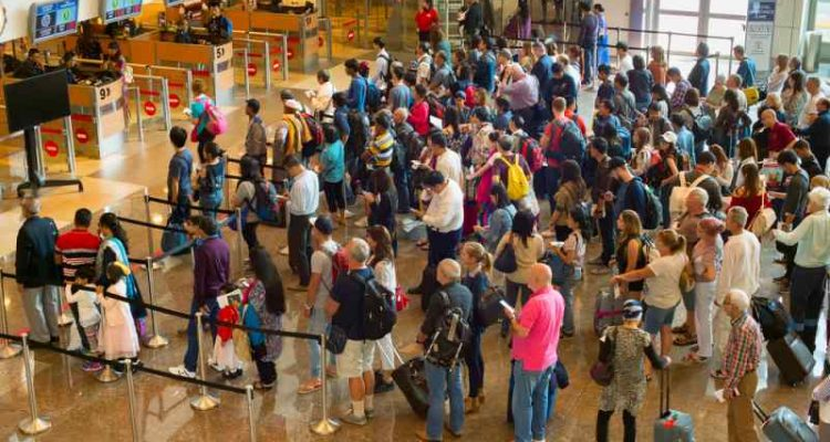 people waiting in line at the airport