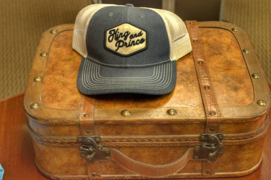King and Prince resort luggage and hat